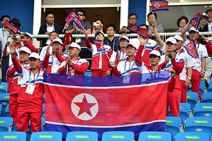 Гражданам Южной Кореи пригрозили арестом за флаги КНДР на Азиатских играх
